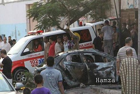 Gaza ambulance at scene of one of six attacks on Gaza ans Islamic Jihad vehicles Sunday morning.