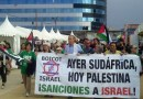 Anti-Israel activists in Gijón, Spain are pictured above calling for a boycott and sanctions against the Jewish state