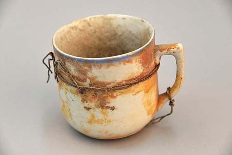 Auschwitz personal belongings – cup / Photo: Paweł Sawicki