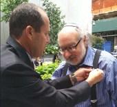 Mayor Nir Barkat giving Jonathan Pollard his Jerusalem gold pin