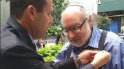 Mayor Nir Barkat giving Jonathan Pollard his Jerusalem gold pin