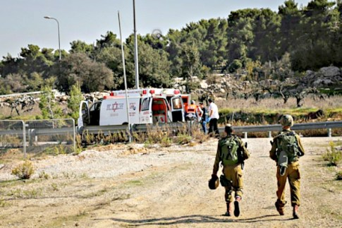 Ambulances evacuate wounded soldiers at the scene where a Palestinian Arab driver rammed his car into Israeli soldiers near Beit Ummar, on November 27, 2015.
