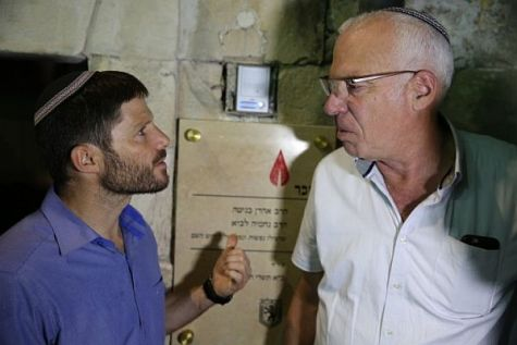 Jewish Home MK Bezalel Smotrich and Agriculture Minister Uri Ariel at the doorpost of a new Jewish home in the Muslim Quarter of Jerusalem's Old City.