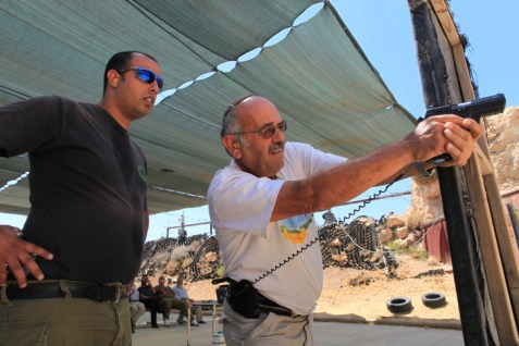 A man learns combat pistol shooting at the Caliber-3 range in Gush Etzion.