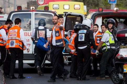 Medics treat a policeman who w