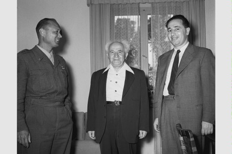 Shimon Peres (R) who was Directer General of the Defense Ministry, with then Defense Minister David Ben Gurion (C), and IDF Chief of Staff Moshe Dayan (L) from 1955.