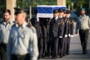The Knesset Honor Guard carries the coffin of Former Israeli President Shimon Peres ahead of the ceremony held at the Knesset square where the public will be invited to pay their last respects before his burial, in Jerusalem, on September 29, 2016.