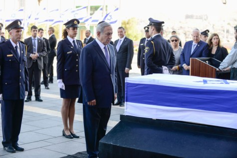 Prime Minister Benjamin Netanyahu pauses in front of the coffin of late former Israeli president Shimon Peres where the public will be invited to pay their last respects before his burial, in Jerusalem, on September 29, 2016.