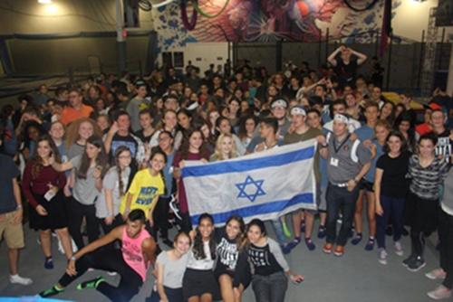 Jewish teens enjoying Southern NCSY's Midnight Madness at Ninja Lounge.