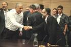 Finance Minister Moshe Kahlon shakes hands with MK Moshe Gafni (R)