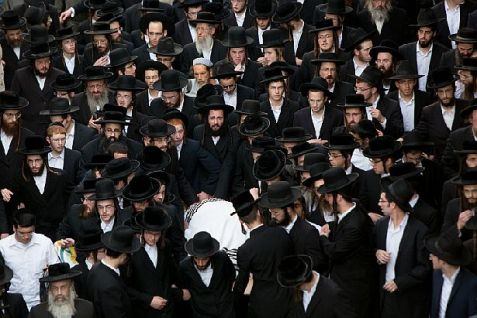 Hareidi-religious men carry the body of a rabbi murdered by an Arab terrorist who rammed his car into a crowd of people standing at a bus stop on Malchei Yisrael Street, and then got out and stabbed those still standing.