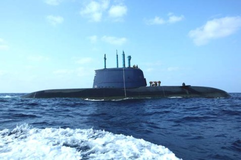 An Israeli navy Dolphin-class submarine in the water off the coast of Haifa