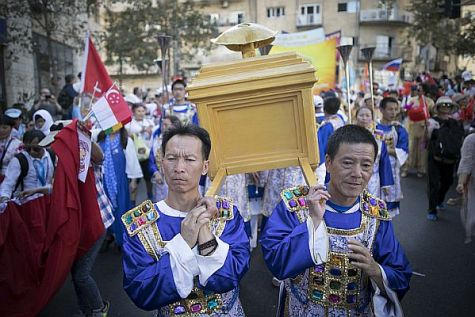 Philippine Christians parade in the Jerusalem March dressed as priests bearing the Ark of the Covenant.