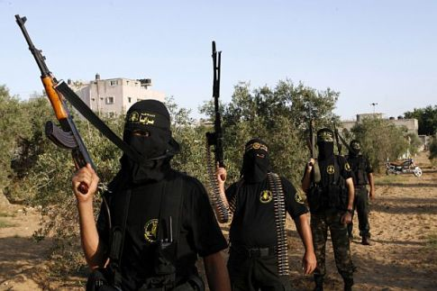 "Masked fighters from the Palestinian Islamic Jihad's military wing ""Saraya Al-Quds"" or ""Jerusalem Brigades"" take part in a military drill."
