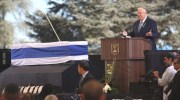 President Reuven RIvlin speaks by the coffin of Former Israeli President Shimon Peres during the state funeral at Mount Herzl, Jerusalem, September 30, 2016.