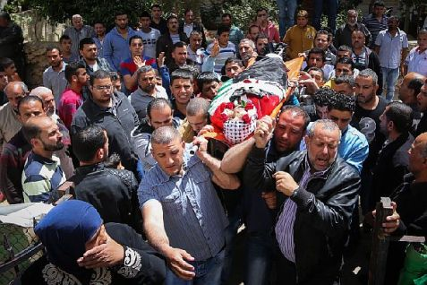 Mourners carry the body of Arab terrorist Ahmed Reyad Shehada during his funeral in Beitunia, a suburb of the Palestinian Authority capital city of Ramallah.  Shehada was shot dead by IDF forces after ramming his vehicle into a group of Israeli soldiers in the Binyamin region.