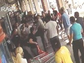 Sunday's assault on an Arab supermarket employee in central Tel Aviv by a group of Border Guard police. / CCTV