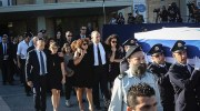 The Peres family walks with the coffin of former Israeli President Shimon Peres at the Knesset as they make their way to Mount Herzl for the State funeral, September 30, 2016.