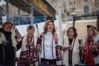 "Members of the ""Women of the Wall"" activist group begin to teach women how to pray in men's tefillin and prayer shawls at the extension of the Western Wall known as Robinson's Arch."