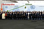Netanyahu and Abbas at global conference photo-op.
