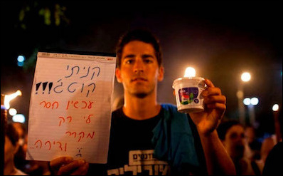 """A young Israeli holds a food container with a sign reading: """"I bought my cottage cheese, now all I need is a fridge and an apartment."""" Housing price inflation was the main domestic issue in the last general election as well as the one before it, but ironically, housing price inflation is a side effect of Israel's economic success. Israelis as a society have become economically wealthy, which in turn helps increase price pressures on the real estate market."""