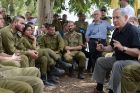 Prime Minister Benjamin Netanyahu meets with IDF soldiers as he tours the southern Israeli border with Gaza.