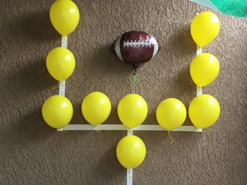 football goal posts uprights yellow balloons