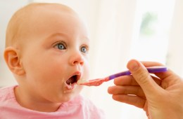 cute baby being fed