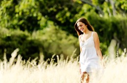 woman walking through field happiness Jule Magazine