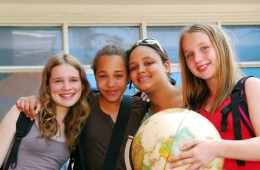 teen girls holding a globe