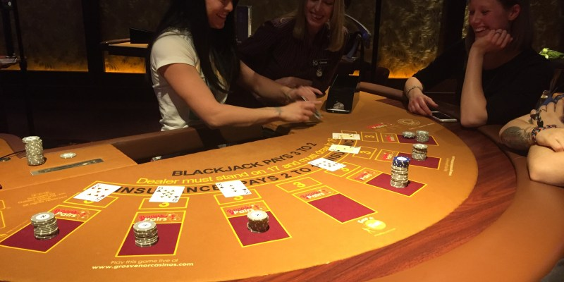 dealing blackjack at casino