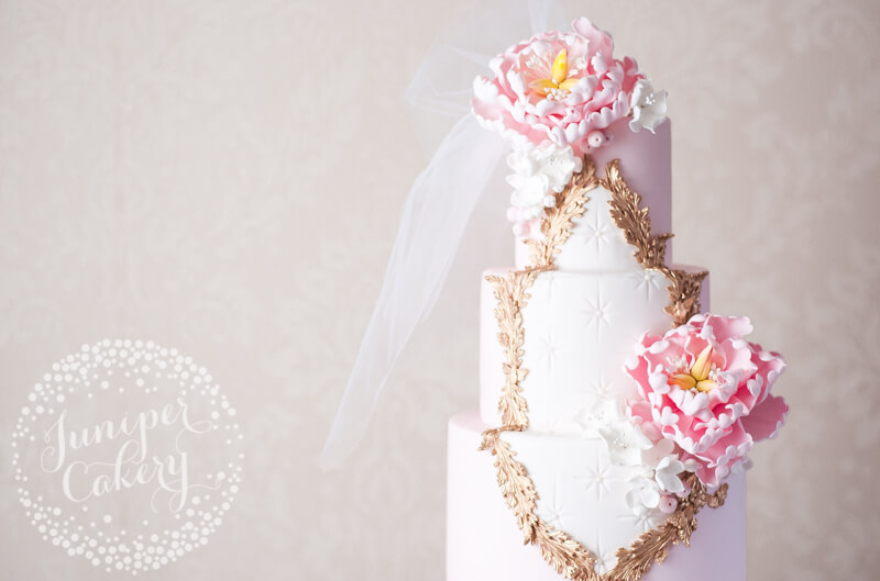 Pink Rococo inspired wedding cake with veil by Juniper Cakery