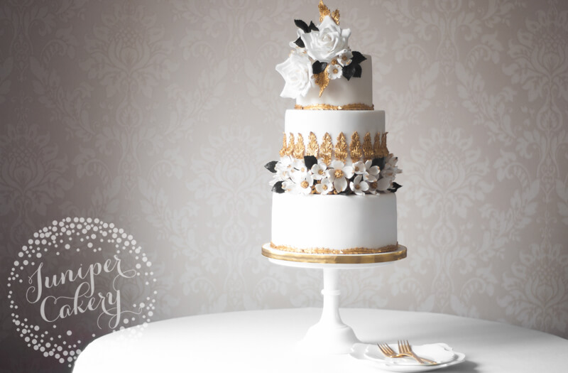 Rococo inspired wedding cake with gilded dogwood flowers by Juniper Cakery