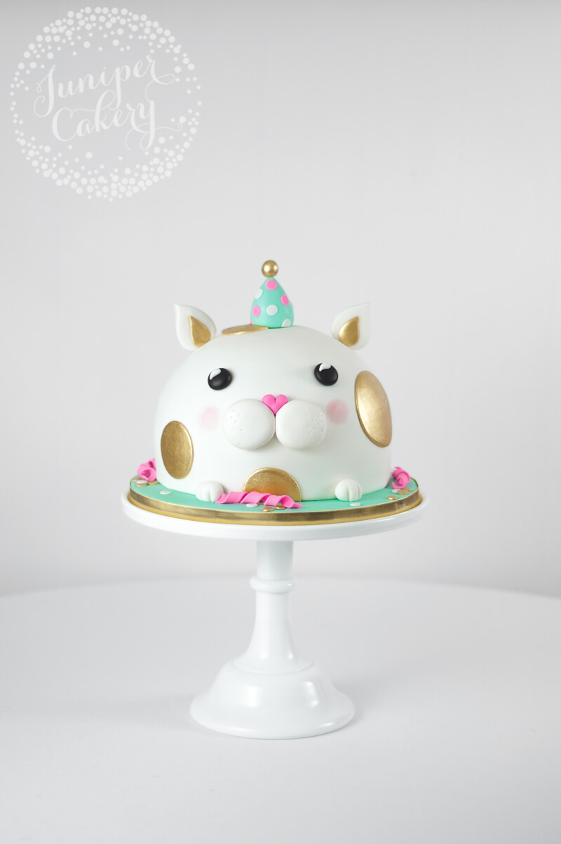 Cat in a party hat birthday cake by Juniper Cakery