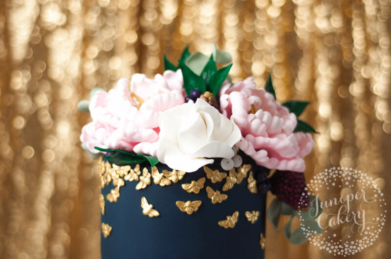 Navy and blush floral cake by Juniper Cakery