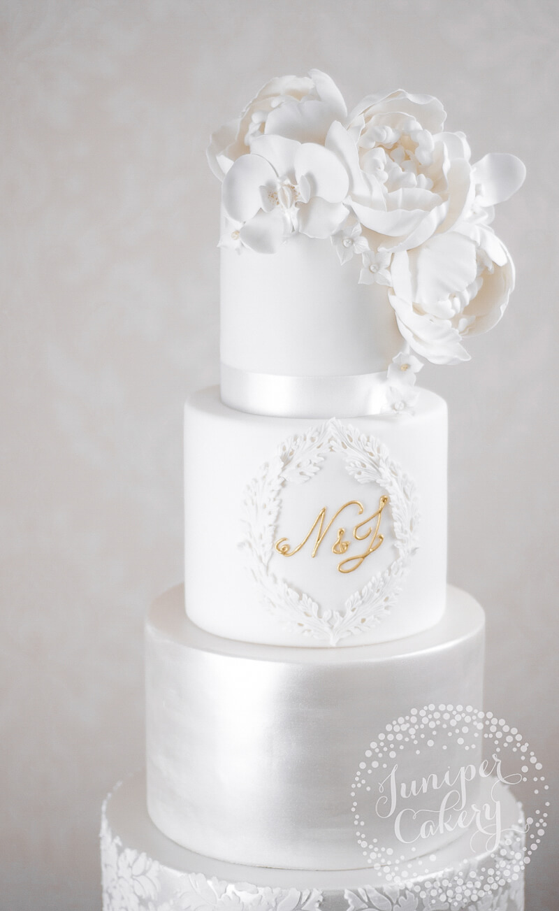Monogram white wedding cake at Rise Hall by Juniper Cakery