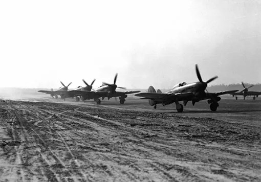 Typhoons from a RCAF fighter squadron getting ready to take off, Netherlands, April 2nd, 1945.