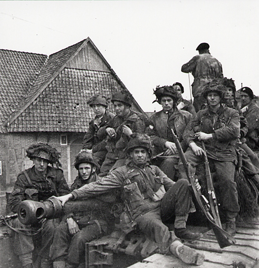 Paratroopers of the 1st Canadian Parachute battalion on a Churchill tank: Privates E. D. Aziz, P. G. Mulroy, Sergeant G. H. Jickels, Privates L. O. Fuson, J. Humeniuk, G. M. Brown, R. H. Carlton. Greven, Germany, April 5th (or 31st March), 1945.