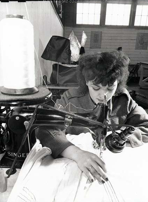 A member of the Army's Women's Corps repairing a parachute.