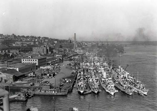Royal Navy and RCN destroyers and corvettes alongside Jetty No. 4, HMC Dockyard, Halifax, 16 October 1942.