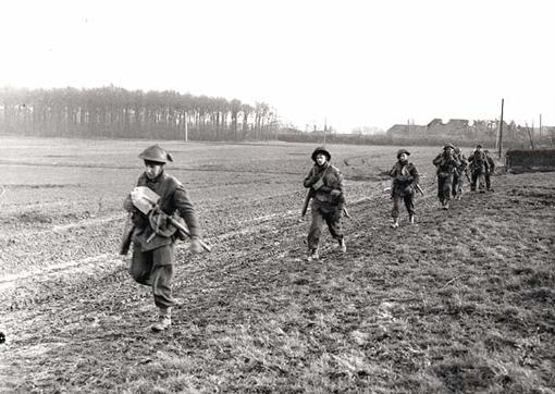 Algonquin Regiment moving forward near the Hochwald Forest, Udem, Germany, March 1st, 1945.