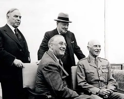 President Franklin D. Roosevelt (sitting, left), Governor General of Canada Lord Athlone (sitting, right), Prime Minister W.L. Mackenzie King (standing, left) and British Prime Minister Winston Churchill (standing, right) at the Quebec Conference in August 1943