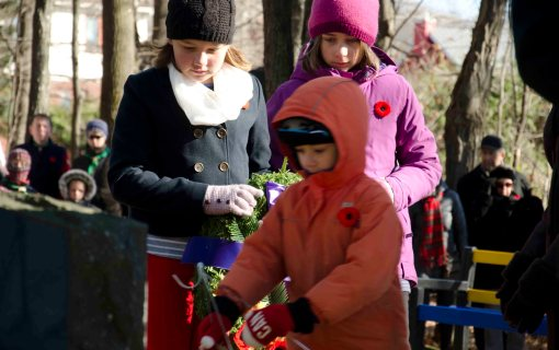 Cecily, Duncan and Lucy preparing to lay the wreath