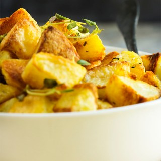 Crispy Roasted Potatoes - There is just one little trick to turning basic roasted potatoes into extra crispy and yummy roasted potatoes. This is the roasted potato side dish you've been looking for. | justalittlebitofbacon.com