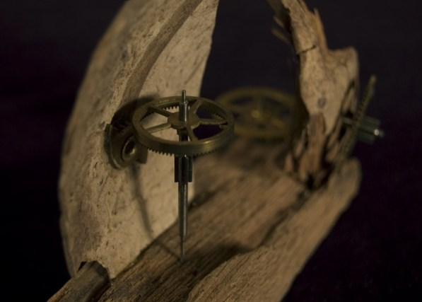 Found objects (coconut shell, wood, & old clock parts)