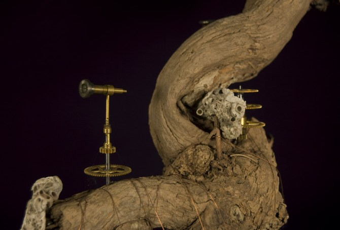 """Found objects (coconut shell, copper wire, wood, shell, coral, small Ganesha statue, & old clock parts) 15"""" x 9"""" x 6.5"""" - 2008"""