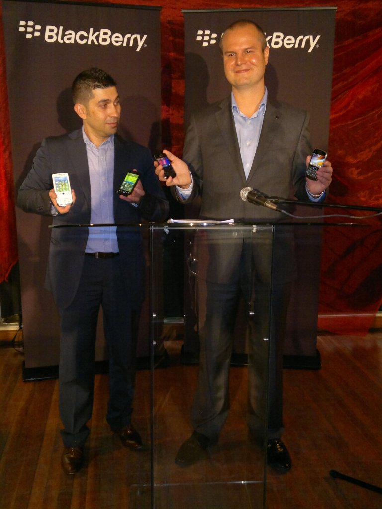 Mr Waldi Wepener and Mr. Rui Brites show off the new BlackBerry OS 7 smartphones