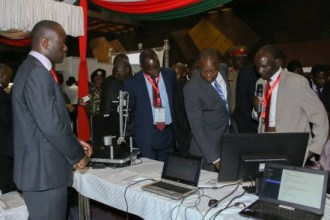 PRESIDENT KENYATTA GOING THROUGH EXHIBITION STANDS AT IPRS LAUNCH