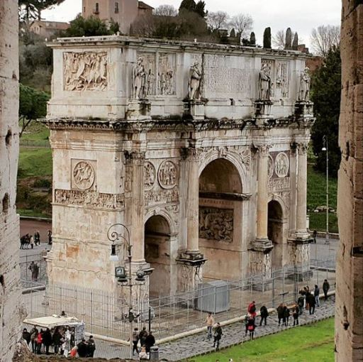 The Arch Of Constantine Arco Di Costantino triumphal arch in Rome between the Colosseum and the Palatine Hill JUUCHINI