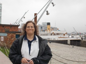 Carah standing in front of one of Titanic's tender ships. It was this ship that ferried Molly Brown onto the Titanic in France.  It is recently restored, and is the last White Star ship in existence.